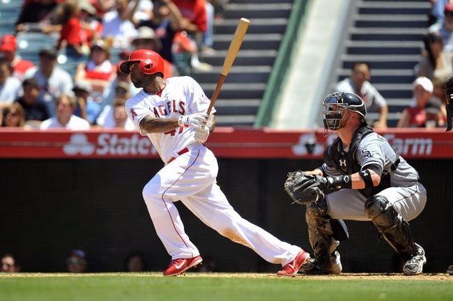 June 8, 2014; Anaheim, CA, USA; Los Angeles Angels second baseman Howie Kendrick (47) hits a single in the fifth inning against the Chicago White Sox at Angel Stadium of Anaheim. Mandatory Credit: Gary A. Vasquez-USA TODAY Sports