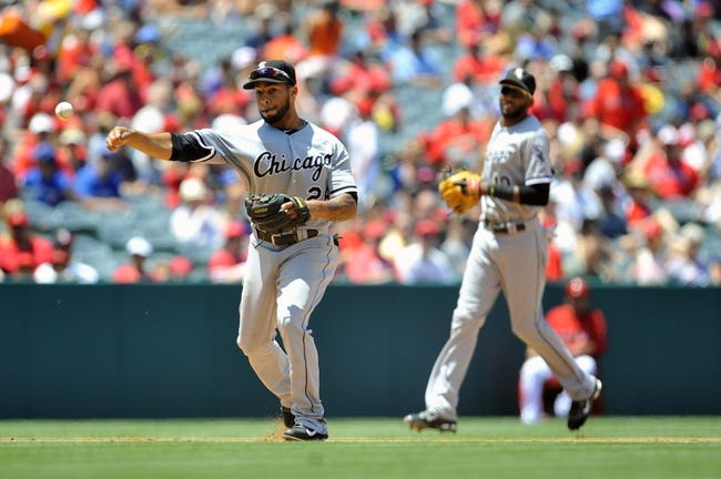 June 8, 2014; Anaheim, CA, USA; Chicago White Sox second baseman Leury Garcia (28) throws to first to complete an out in the fourth inning against the Los Angeles Angels at Angel Stadium of Anaheim. Mandatory Credit: Gary A. Vasquez-USA TODAY Sports