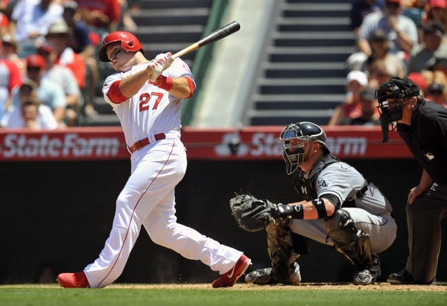 June 8, 2014; Anaheim, CA, USA; Los Angeles Angels center fielder Mike Trout (27) hits a single in the fifth inning against the Chicago White Sox at Angel Stadium of Anaheim. Mandatory Credit: Gary A. Vasquez-USA TODAY Sports