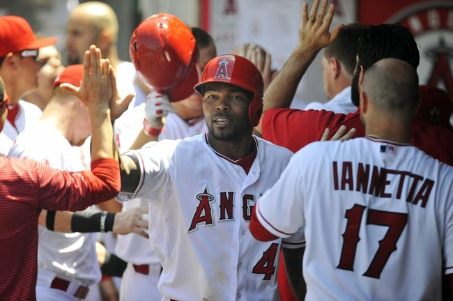 June 8, 2014; Anaheim, CA, USA; Los Angeles Angels second baseman Howie Kendrick (47) celebrates after scoring a run in the fifth inning against the Chicago White Sox at Angel Stadium of Anaheim. Mandatory Credit: Gary A. Vasquez-USA TODAY Sports