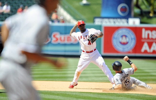 June 8, 2014; Anaheim, CA, USA; Chicago White Sox second baseman Gordon Beckham (15) slides into second as Los Angeles Angels second baseman Howie Kendrick (47) throws to first in the seventh inning at Angel Stadium of Anaheim. Mandatory Credit: Gary A. Vasquez-USA TODAY Sports