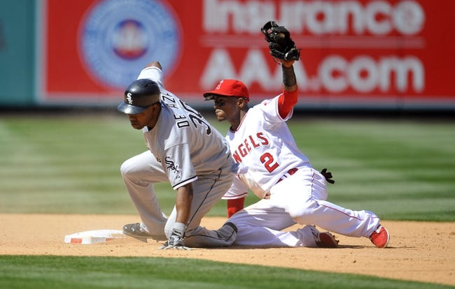 June 8, 2014; Anaheim, CA, USA; Chicago White Sox left fielder Alejandro De Aza (30) is safe at second against the tag of Los Angeles Angels shortstop Erick Aybar (2) in the eighth inning at Angel Stadium of Anaheim. Mandatory Credit: Gary A. Vasquez-USA TODAY Sports