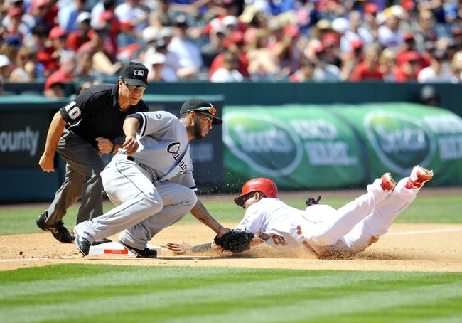 June 8, 2014; Anaheim, CA, USA; Los Angeles Angels shortstop Erick Aybar (2) is caught stealing third against the tag of  Chicago White Sox third baseman Leury Garcia (28) in the seventh inning at Angel Stadium of Anaheim. Mandatory Credit: Gary A. Vasquez-USA TODAY Sports
