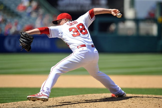 June 8, 2014; Anaheim, CA, USA; Los Angeles Angels relief pitcher Joe Smith (38) pitches the eighth inning against the Chicago White Sox at Angel Stadium of Anaheim. Mandatory Credit: Gary A. Vasquez-USA TODAY Sports