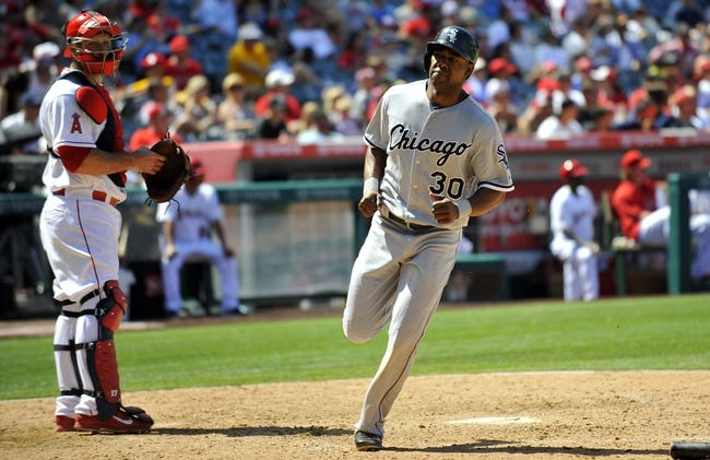 June 8, 2014; Anaheim, CA, USA; Chicago White Sox left fielder Alejandro De Aza (30) scores a run in the eighth inning against the Los Angeles Angels at Angel Stadium of Anaheim. Mandatory Credit: Gary A. Vasquez-USA TODAY Sports
