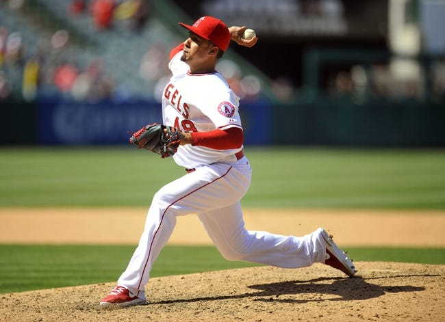 June 8, 2014; Anaheim, CA, USA; Los Angeles Angels relief pitcher Ernesto Frieri (49) pitches the ninth inning against the Chicago White Sox at Angel Stadium of Anaheim. Mandatory Credit: Gary A. Vasquez-USA TODAY Sports