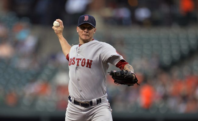 Jun 9, 2014; Baltimore, MD, USA; Boston Red Sox pitcher Jake Peavey (44) throws in the second inning against the Baltimore Orioles at Oriole Park at Camden Yards. Mandatory Credit: Joy R. Absalon-USA TODAY Sports