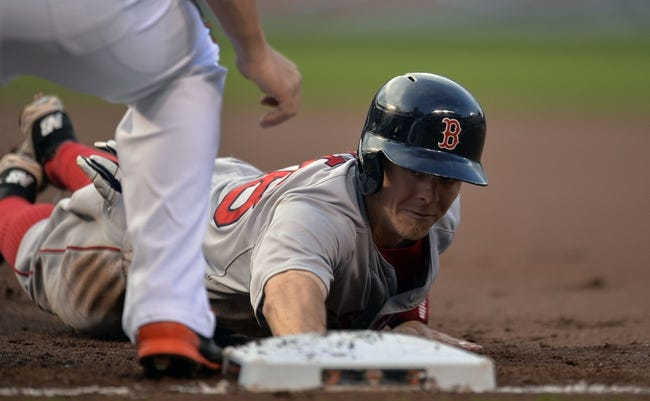 Jun 9, 2014; Baltimore, MD, USA; Boston Red Sox left fielder Brock Holt (26) dives back to first base safely in the first inning against the Baltimore Orioles at Oriole Park at Camden Yards. Mandatory Credit: Joy R. Absalon-USA TODAY Sports