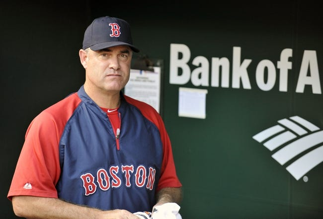 Jun 9, 2014; Baltimore, MD, USA; Boston Red Sox manager John Farrell (53) in the dugout prior to a game against the Baltimore Orioles at Oriole Park at Camden Yards. Mandatory Credit: Joy R. Absalon-USA TODAY Sports