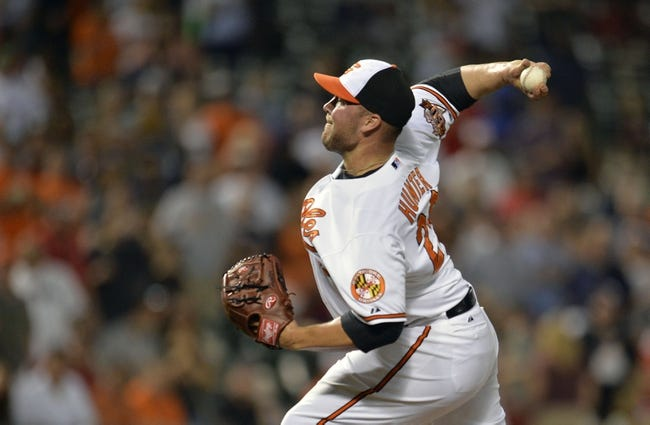 Jun 9, 2014; Baltimore, MD, USA; Baltimore Orioles pitcher Tommy Hunter (29) pitches in the ninth inning against the Boston Red Sox at Oriole Park at Camden Yards. The Orioles defeated the Red Sox 4-0. Mandatory Credit: Joy R. Absalon-USA TODAY Sports