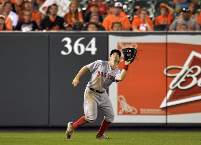 Jun 9, 2014; Baltimore, MD, USA; Boston Red Sox left fielder Brock Holt (26) catches a pop-up by Baltimore Orioles center fielder David Lough (not shown) in the sixth inning at Oriole Park at Camden Yards. The Orioles defeated the Red Sox 4-0. Mandatory Credit: Joy R. Absalon-USA TODAY Sports