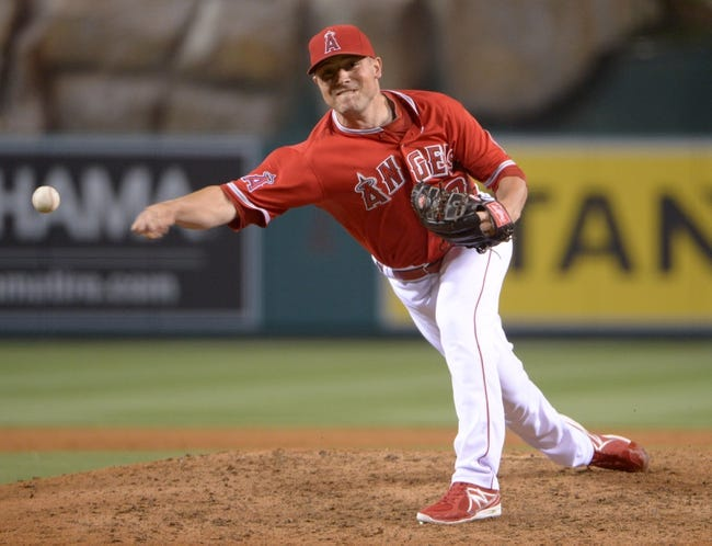 Jun 9, 2014; Anaheim, CA, USA; Los Angeles Angels reliever Joe Smith delivers a pitch against the Oakland Athletics at Angel Stadium of Anaheim. The Angels defeated the Athletics 4-1. Mandatory Credit: Kirby Lee-USA TODAY Sports