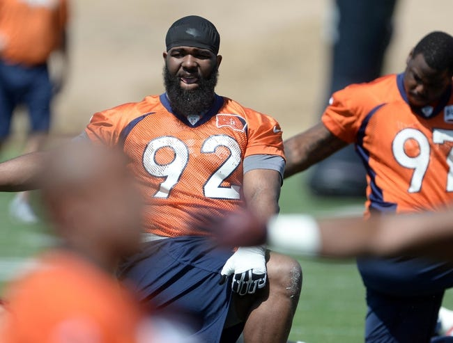 Jun 10, 2014; Denver, CO, USA; Denver Broncos defensive tackle Sylvester Williams (92) warms up during mini camp at the Broncos practice facility. Mandatory Credit: Ron Chenoy-USA TODAY Sports