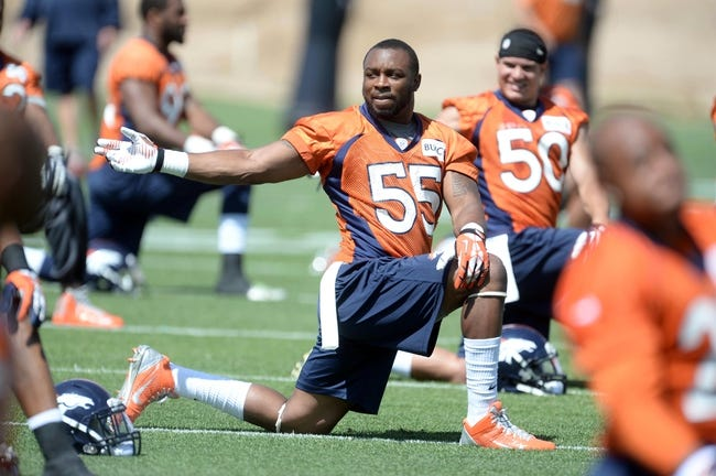 Jun 10, 2014; Denver, CO, USA; Denver Broncos linebacker Lerentee McCray (55) warms up during mini camp at the Broncos practice facility. Mandatory Credit: Ron Chenoy-USA TODAY Sports