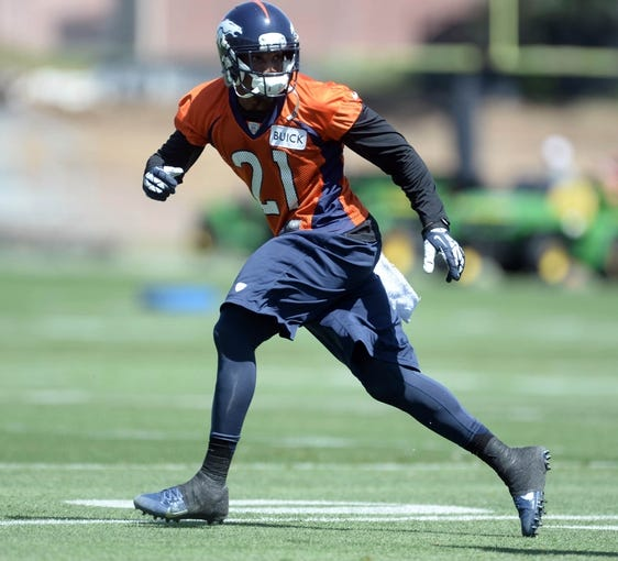 Jun 10, 2014; Denver, CO, USA; Denver Broncos cornerback Aqib Talib (21) runs a play during mini camp drills at the Broncos practice facility. Mandatory Credit: Ron Chenoy-USA TODAY Sports