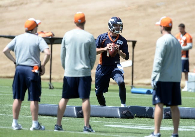 Jun 10, 2014; Denver, CO, USA; Denver Broncos quarterback Brock Osweiler (17) warms up during mini camp drills at the Broncos practice facility. Mandatory Credit: Ron Chenoy-USA TODAY Sports
