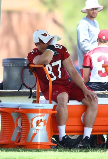 Jun 10, 2014; Tempe, AZ, USA; Arizona Cardinals tight end Troy Niklas sits on the sidelines wearing a cast on his hand during mini camp at the teams Tempe training facility. Mandatory Credit: Mark J. Rebilas-USA TODAY Sports