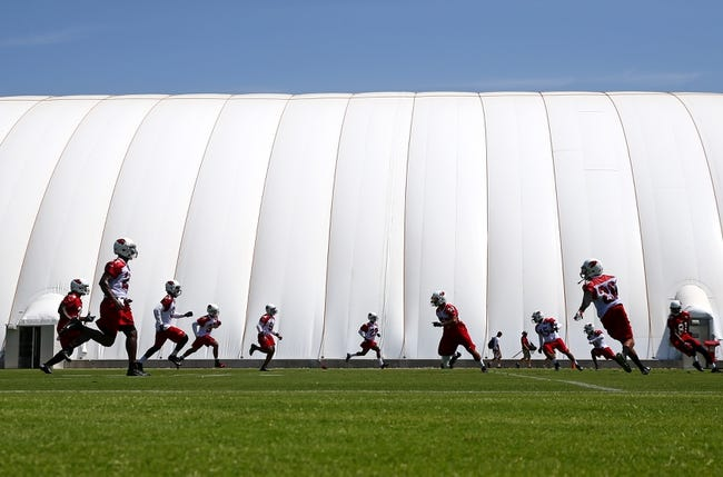 Jun 10, 2014; Tempe, AZ, USA; Arizona Cardinals players conduct drills during mini camp at the teams Tempe training facility. Mandatory Credit: Mark J. Rebilas-USA TODAY Sports