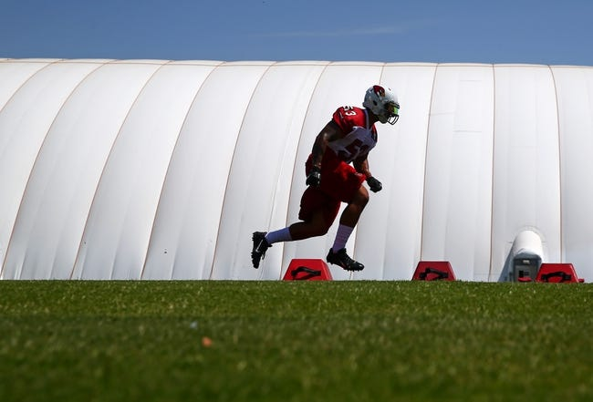 Jun 10, 2014; Tempe, AZ, USA; Arizona Cardinals linebacker JoJo Dickson runs drills during mini camp at the teams Tempe training facility. Mandatory Credit: Mark J. Rebilas-USA TODAY Sports