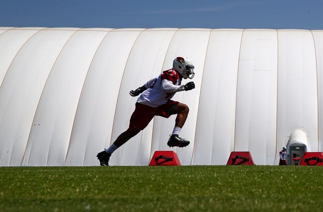 Jun 10, 2014; Tempe, AZ, USA; Arizona Cardinals linebacker Jonathan Brown runs drills during mini camp at the teams Tempe training facility. Mandatory Credit: Mark J. Rebilas-USA TODAY Sports