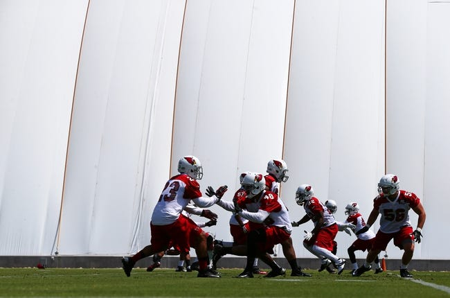 Jun 10, 2014; Tempe, AZ, USA; Arizona Cardinals players run drills during mini camp at the teams Tempe training facility. Mandatory Credit: Mark J. Rebilas-USA TODAY Sports