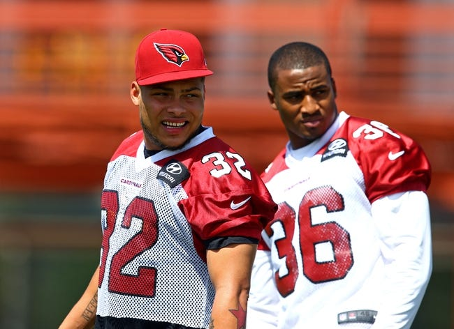 Jun 10, 2014; Tempe, AZ, USA; Arizona Cardinals safety Tyrann Mathieu (left) and cornerback Deone Bucannon during mini camp at the teams Tempe training facility. Mandatory Credit: Mark J. Rebilas-USA TODAY Sports