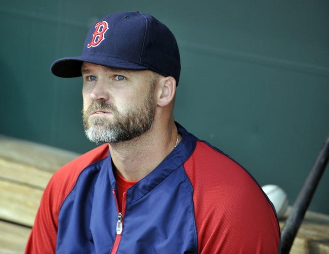 Jun 10, 2014; Baltimore, MD, USA; Boston Red Sox catcher David Ross (3) in the dugout prior to a game against the Baltimore Orioles at Oriole Park at Camden Yards. Mandatory Credit: Joy R. Absalon-USA TODAY Sports