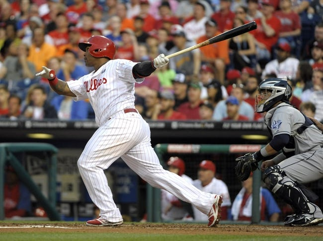 Jun 10, 2014; Philadelphia, PA, USA; Philadelphia Phillies right fielder Marlon Byrd (3) watches his three run home run in the 4th inning against the San Diego Padres at Citizens Bank Park. Mandatory Credit: Eric Hartline-USA TODAY Sports