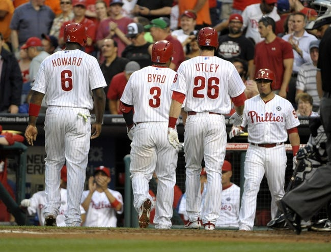 Jun 10, 2014; Philadelphia, PA, USA; Philadelphia Phillies right fielder Marlon Byrd (3) walsk towards the dugout with first baseman Ryan Howard (6) and second baseman Chase Utley (26) after hitting three run home run during the fourth inning against the San Diego Padres at Citizens Bank Park. Mandatory Credit: Eric Hartline-USA TODAY Sports