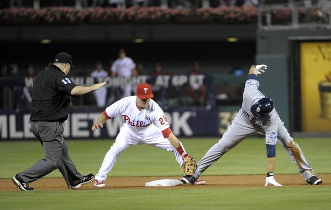 Jun 10, 2014; Philadelphia, PA, USA; San Diego Padres left fielder Carlos Quentin (18) slides safely into second base ahead of tag by Philadelphia Phillies second baseman Chase Utley (26) as umpire Todd Tichenor (13) calls him safe in the seventh inning at Citizens Bank Park. Phillies defeated the Padres, 5-2. Mandatory Credit: Eric Hartline-USA TODAY Sports