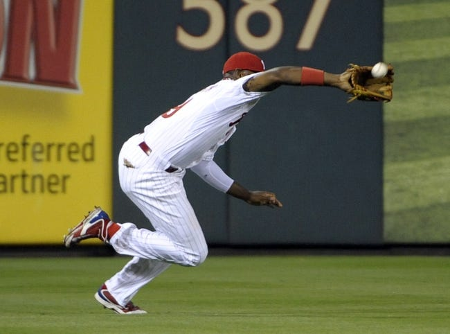 Jun 10, 2014; Philadelphia, PA, USA; Philadelphia Phillies left fielder Domonic Brown (9) makes a catch against the San Diego Padres in the seventh inning at Citizens Bank Park. Phillies defeated the Padres, 5-2. Mandatory Credit: Eric Hartline-USA TODAY Sports