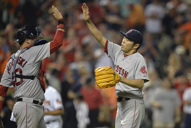Jun 10, 2014; Baltimore, MD, USA; Boston Red Sox pitcher Koji Uehara (19) high-fives catcher A.J. Pierzinsky (40) after a game against the Baltimore Orioles at Oriole Park at Camden Yards. The Red Sox defeated the Orioles 1-0. Mandatory Credit: Joy R. Absalon-USA TODAY Sports