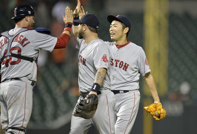 Jun 10, 2014; Baltimore, MD, USA; Boston Red Sox teammates A.J. Pierzynski (left) Mike Napoli (center) and Koji Uehara (right) celebrate after a game against the Baltimore Orioles at Oriole Park at Camden Yards. The Red Sox defeated the Orioles 1-0. Mandatory Credit: Joy R. Absalon-USA TODAY Sports