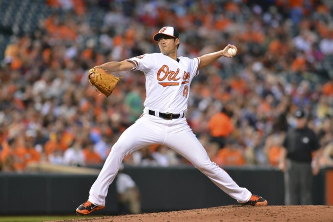 Jun 11, 2014; Baltimore, MD, USA; Baltimore Orioles starting pitcher Wei-Yin Chen (16) pitches during the third inning against the Boston Red Sox  at Oriole Park at Camden Yards. Mandatory Credit: Tommy Gilligan-USA TODAY Sports