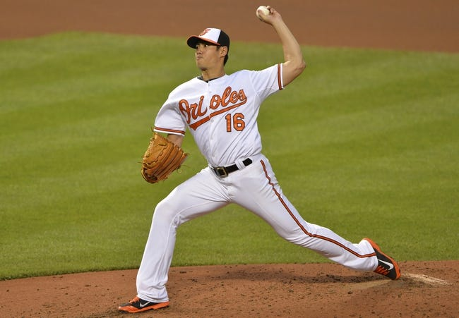 Jun 11, 2014; Baltimore, MD, USA; Baltimore Orioles starting pitcher Wei-Yin Chen (16) pitches during the fourth inning against the Boston Red Sox  at Oriole Park at Camden Yards. Mandatory Credit: Tommy Gilligan-USA TODAY Sports