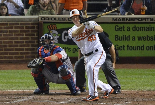 Jun 11, 2014; Baltimore, MD, USA;  Baltimore Orioles catcher Nick Hundley (40) breaks his bat  and reaches safely on a fielders choice during the sixth inning against the Boston Red Sox at Oriole Park at Camden Yards. Mandatory Credit: Tommy Gilligan-USA TODAY Sports