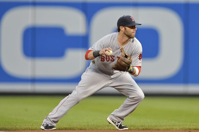 Jun 11, 2014; Baltimore, MD, USA;  Boston Red Sox second baseman Dustin Pedroia (15) fields a grounder during the first inning against the Baltimore Orioles at Oriole Park at Camden Yards. Mandatory Credit: Tommy Gilligan-USA TODAY Sports