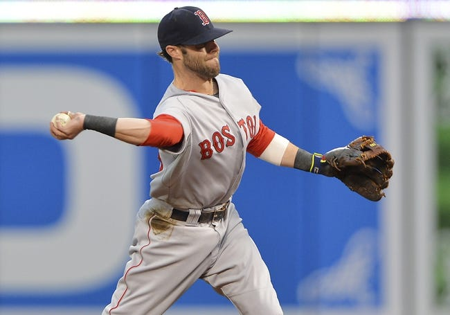 Jun 11, 2014; Baltimore, MD, USA;  Boston Red Sox second baseman Dustin Pedroia (15) throws to first base during the first inning against the Baltimore Orioles at Oriole Park at Camden Yards. Mandatory Credit: Tommy Gilligan-USA TODAY Sports