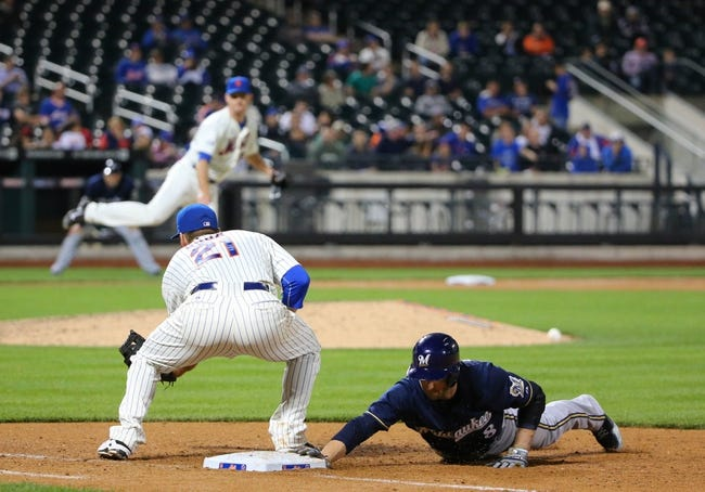 Jun 11, 2014; New York, NY, USA;  Milwaukee Brewers right fielder Ryan Braun (8) slides back safe to first as New York Mets first baseman Lucas Duda (21) is late with the tag during the ninth inning at Citi Field. Mandatory Credit: Anthony Gruppuso-USA TODAY Sports