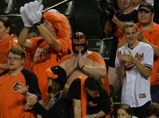 Jun 11, 2014; Baltimore, MD, USA;  Fans stand about the Baltimore Orioles during the ninth inning Boston Red Sox at Oriole Park at Camden Yards. Baltimore Orioles defeated Boston Red Sox 6-0. Mandatory Credit: Tommy Gilligan-USA TODAY Sports