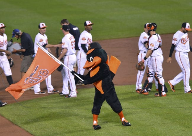 Jun 11, 2014; Baltimore, MD, USA;  Baltimore Orioles celebrate on the field after defeating the Boston Red Sox 6-0 at Oriole Park at Camden Yards.  Mandatory Credit: Tommy Gilligan-USA TODAY Sports