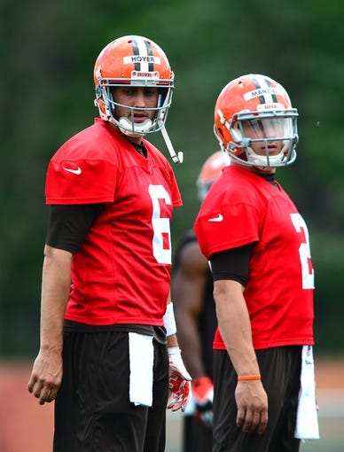 Jun 12, 2014; Berea, OH, USA; Cleveland Browns quarterback Brian Hoyer (left) and Johnny Manziel during minicamp at Browns training facility. Mandatory Credit: Andrew Weber-USA TODAY Sports