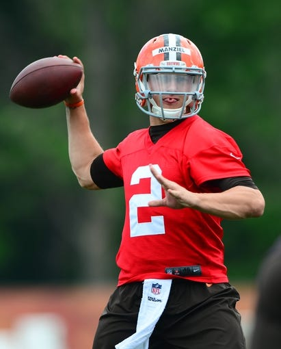 Jun 12, 2014; Berea, OH, USA; Cleveland Browns quarterback Johnny Manziel throws a pass during minicamp at Browns training facility. Mandatory Credit: Andrew Weber-USA TODAY Sports