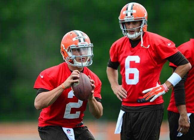 Jun 12, 2014; Berea, OH, USA; Cleveland Browns quarterback Johnny Manziel looks to pass as Brian Hoyer looks on during minicamp at Browns training facility. Mandatory Credit: Andrew Weber-USA TODAY Sports