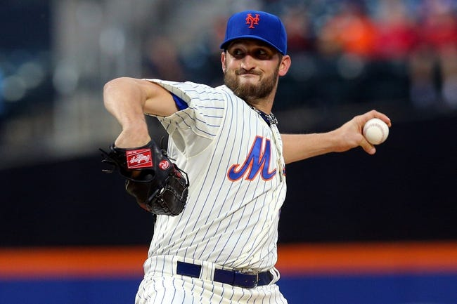 Jun 12, 2014; New York, NY, USA; New York Mets starting pitcher Jonathon Niese (49) pitches against the Milwaukee Brewers during the first inning at Citi Field. Mandatory Credit: Brad Penner-USA TODAY Sports