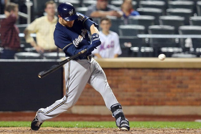 Jun 12, 2014; New York, NY, USA; Milwaukee Brewers catcher Jonathan Lucroy (20) hits a two-run home run against the New York Mets during the thirteenth inning at Citi Field. The Brewers won 5-1 in thirteen innings. Mandatory Credit: Brad Penner-USA TODAY Sports