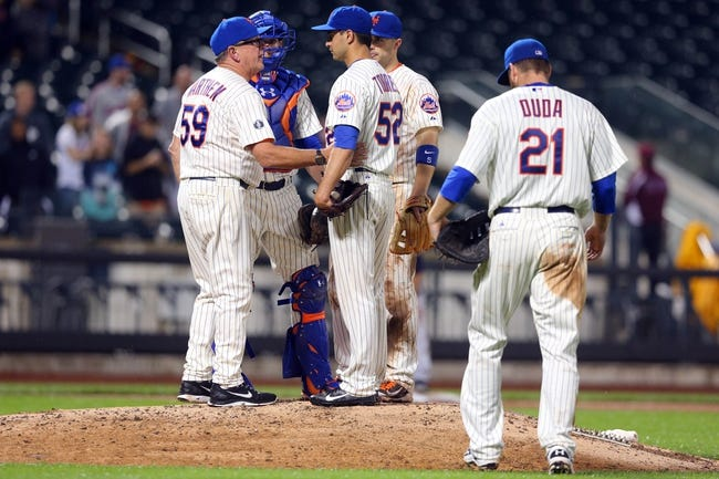 Jun 12, 2014; New York, NY, USA; New York Mets pitching coach Dan Warthen (59) talks to New York Mets relief pitcher Carlos Torres (52) during the twelfth inning against the Milwaukee Brewers at Citi Field. The Brewers won 5-1 in thirteen innings. Mandatory Credit: Brad Penner-USA TODAY Sports