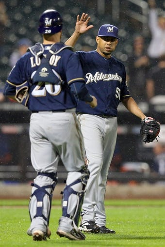 Jun 12, 2014; New York, NY, USA; Milwaukee Brewers relief pitcher Francisco Rodriguez (57) celebrates with Milwaukee Brewers catcher Jonathan Lucroy (20) after beating the New York Mets 5-1 at Citi Field. Mandatory Credit: Brad Penner-USA TODAY Sports
