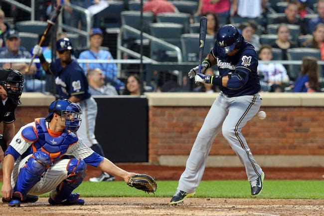 Jun 12, 2014; New York, NY, USA; Milwaukee Brewers third baseman Aramis Ramirez (16) is hit by a pitch during the fourth inning against the New York Mets at Citi Field. The Brewers won 5-1 in thirteen innings. Mandatory Credit: Brad Penner-USA TODAY Sports