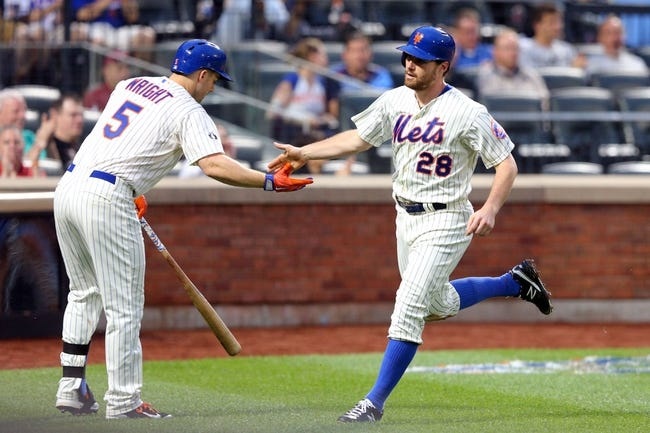 Jun 12, 2014; New York, NY, USA; New York Mets second baseman Daniel Murphy (28) is congratulated after scoring a run against the Milwaukee Brewers by New York Mets third baseman David Wright (5) during the fourth inning at Citi Field. The Brewers won 5-1 in thirteen innings. Mandatory Credit: Brad Penner-USA TODAY Sports